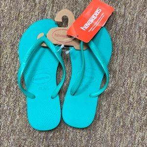 Havaianas mint green flip flops